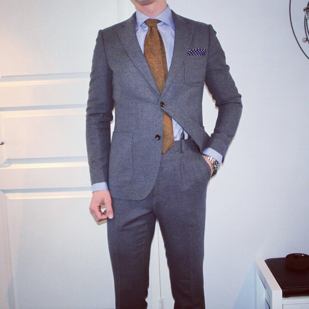 blå kostym